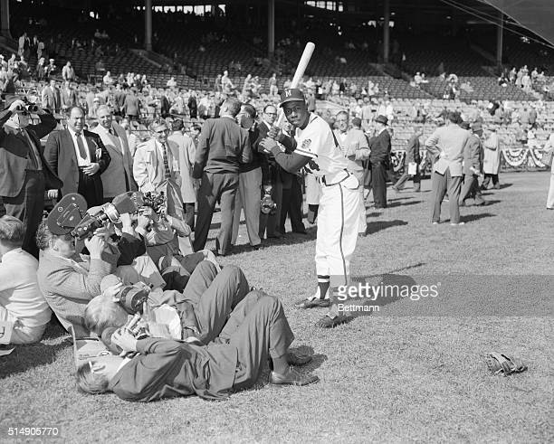 10/5/1957Milwaukee WI Hank Aaron slugging Braves outfielder poses for newsreel cameramen today as the third World Series game gets underway
