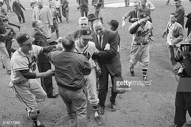 New York, New York- Milwaukee Braves' pitching hero Warren Spahn is encircled by greeters including Joseph Cairnes President of the Braves; Casey...
