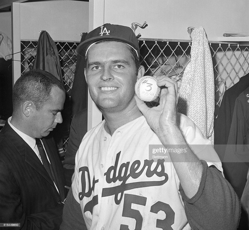 Los Angeles, CA- Dodger Stadium. Jubilant, Dodgers' Don Drysdale holds up the ball which tells the story of World Series game number three... which made it three wins in a row for the Los Angeles Dodgers. Drysdale broke the backs of the New York Yankees 10/5 with a three-hit, 1-0 victory, with his peerless picthing, Dodgers trademark for all 3 games.