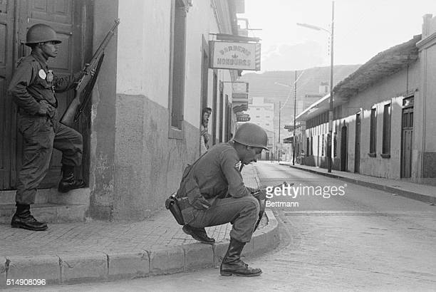 10/5/1963Tegucigalpa HondurasArmed troops stand guard on a street corner in Tegucigalpa after antijunta sharpshooters opened fire on army troops in a...