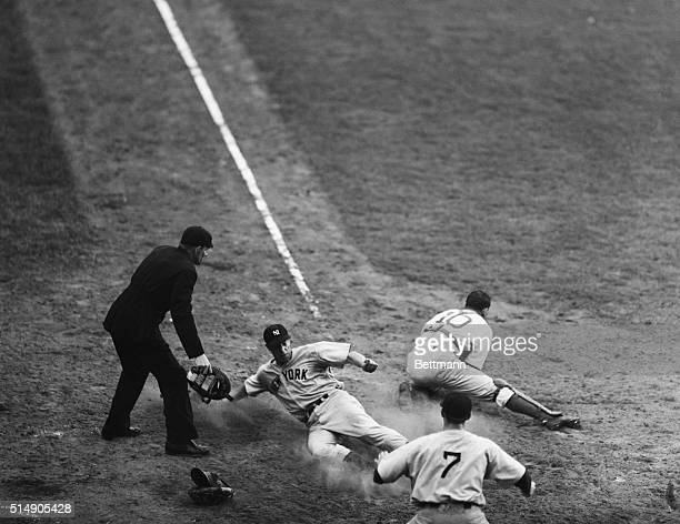 New York: Joe Di Maggio of the New York Yankees slides safely home with the winning run in Yankee half of the 9th inning of the 4th World series game...