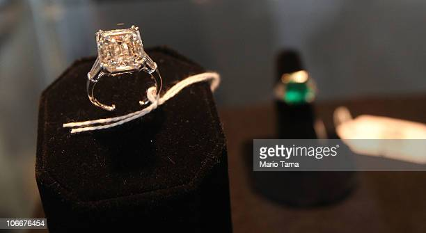A 1054carat ladies emerald cut diamond engagement ring is displayed with other jewelry at a press preview of an auction of 400 pieces of personal...