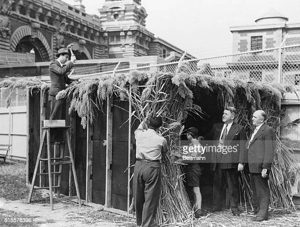New York: Tempary detained Jews at Ellis Island put the finishing touches to their Succah to commemorate the eight day Succoth holiday which begins...