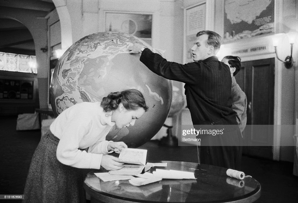 Moscow, Russia- Technicians at the Moscow Planetarium trace the orbit of Sputnik, the Soviet earth satellite, on a huge globe. On October 11th, a robot moonwatcher in Cambridge, Mass. fixed Sputnik's course and altitude changes.