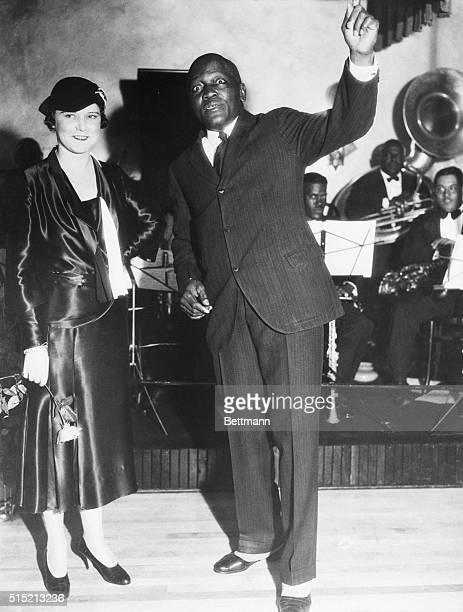 10/7/1931Los Angeles CA Portrait of Jack Johnson introducing his fourth wife the former Mrs Irene Pineau at the opening of his new nightclub The...
