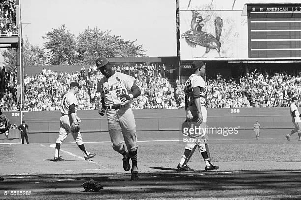 10/7/1964St Louis MO Lou Brock of the Cardinals scores the first run of the World Series opener without a play on him in the first inning He raced in...