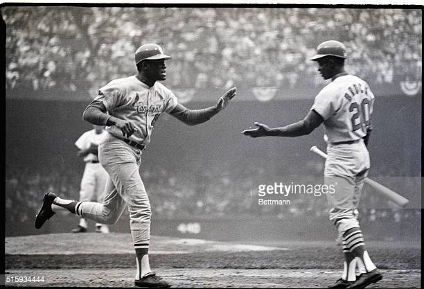 10/7/1968Tiger Stadium Big gunners in Cardinals assualt here 10/6 meet at plate as pitcher Bob Gibson homers and is greeted by Lou Brock in the 4th...