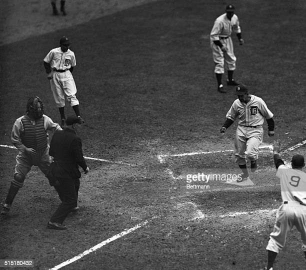 Original caption reads as follows Mickey Cochrane of the Detroit Tigers is seen crossing the home plate with the winning run in the last half of the...