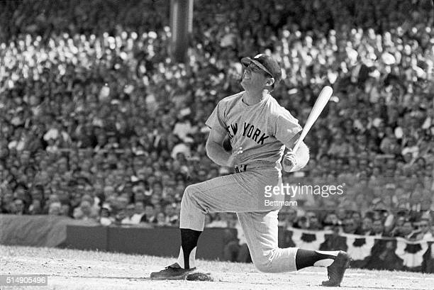 Cincinnati, OH: Yankee slugger Mickey Mantle, his face contorted with pain, swings away in the fourth inning of the World Series game here 10/8....
