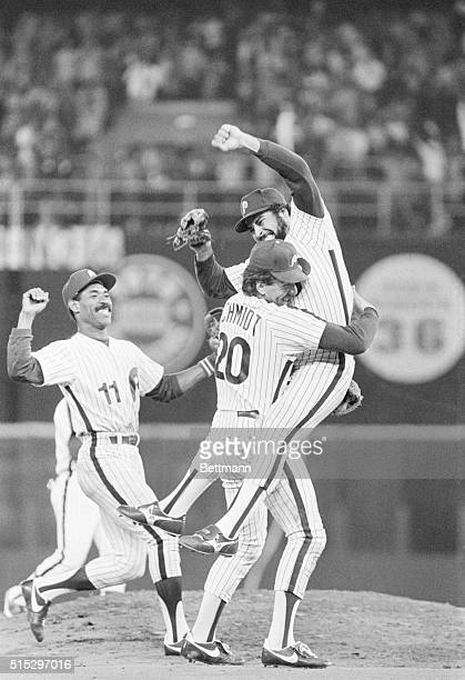 10/8/1983Philadelphia PA Phillies' relief pitcher Al Hlland leaps into the arms of third baseman Mike Schmidt as they defeated the Dodgers to win the...