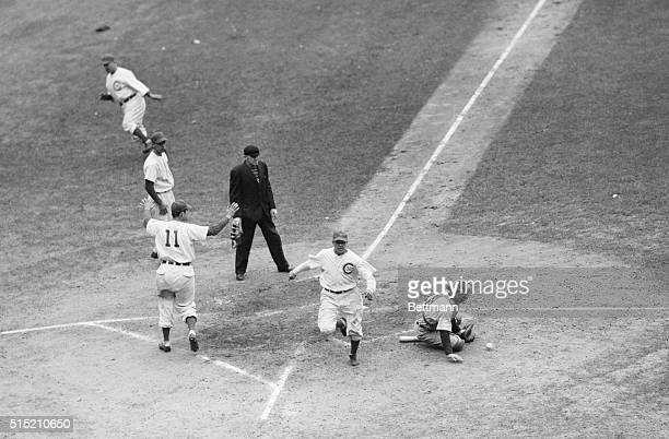 Roy Hughes of the Cubs is shown scoring the second run for the Chicago Cubs in the fifth inning of the sixth World Series game at Wrigley Field He...
