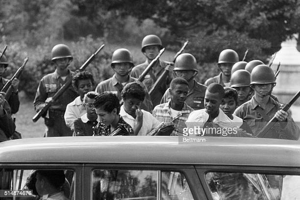 10/9/1957Little Rock AR Nine Negro students attending central High School are shown leaving the school under protection of Federalized Arkansas...