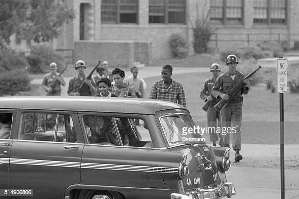 10/9/1957Little Rock AR US Army troops assist with integration escorting students as they leave the school
