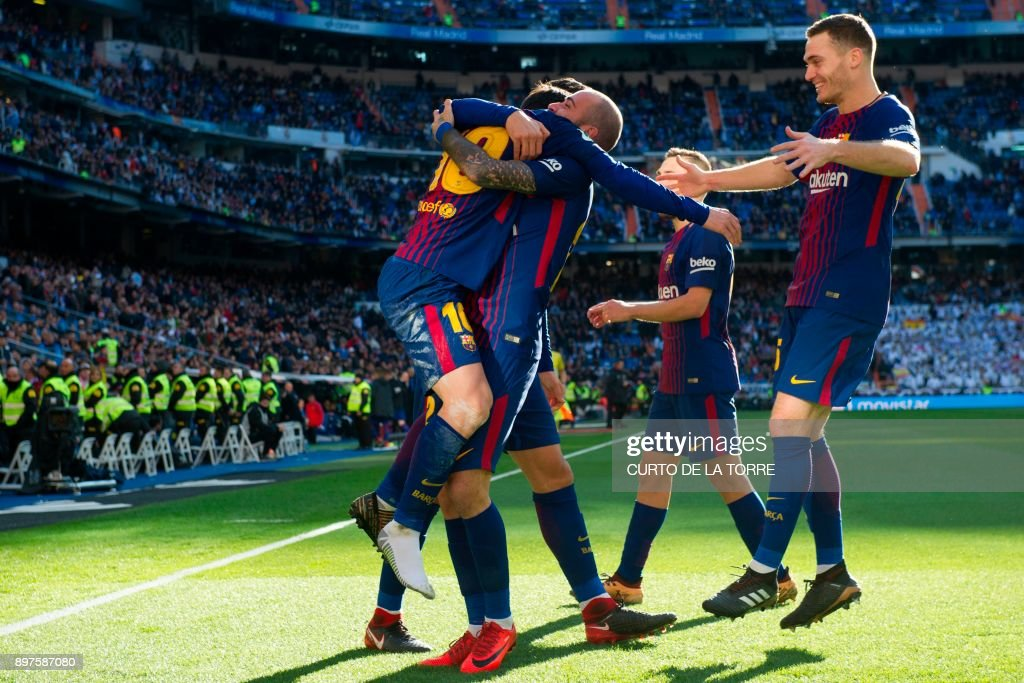 10Barcelona's Spanish midfielder Aleix Vidal (C) celebrates with teammates after scoring during the Spanish League 'Clasico' football match Real Madrid CF vs FC Barcelona at the Santiago Bernadene stadium in Madrid on December 23, 2017. /