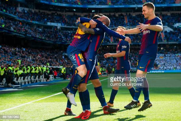 10Barcelona's Spanish midfielder Aleix Vidal celebrates with teammates after scoring during the Spanish League 'Clasico' football match Real Madrid...