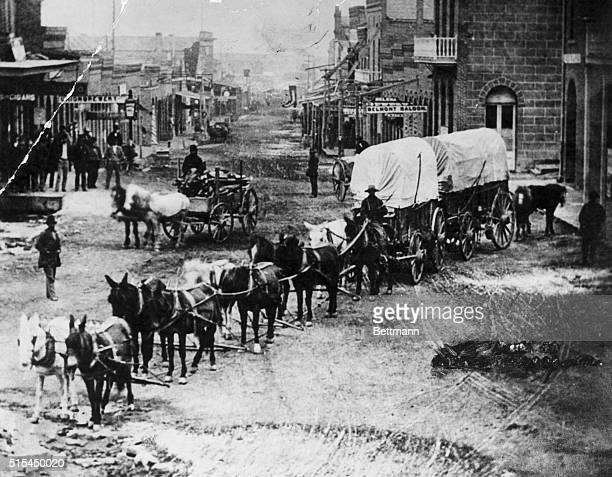 A 10horse team pulls covered wagons down the main street of Helena Montana in June 1870 after the discovery of gold there in 1864