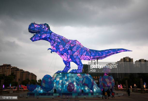 Meter tall dinosaur lantern is illuminated at a tourist attraction on April 19, 2020 in Changzhou, Jiangsu Province of China.