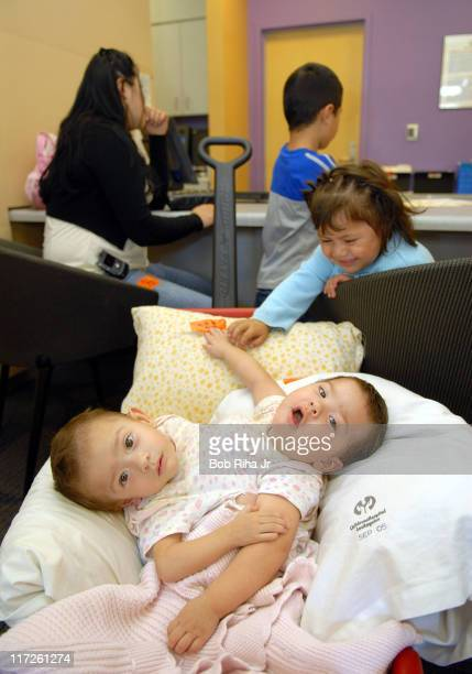 10monthold conjoined twins Regina and Renata and their siblings Marianna and Freddy with their mother Sonia Salinas Fierros upon arrival at Childrens...