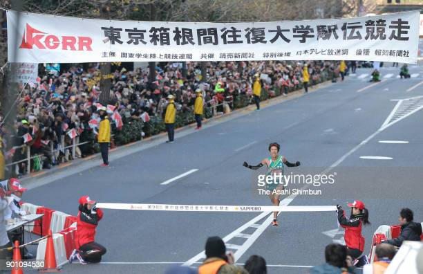 10th and final runner Takaya Hashima of Aoyama Gakuin University crosses the finish tape to win during day two of the 94th Hakone Ekiden on January 3...