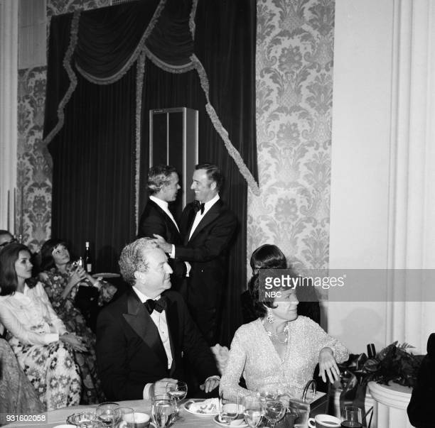 CARSON '10th Anniversary Party' Pictured Johnny Carson comedian Dick Martin NBC President Julian Goodman and wife Betty Davis during the 'Tonight...
