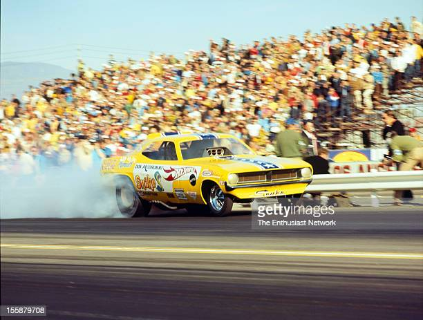 10th Annual NHRA Winternationals 1970 Pomona Don The Snake Prudhomme's Plymouth Cuda funny car blasts down the strip thanks to the supercharged Hemi...