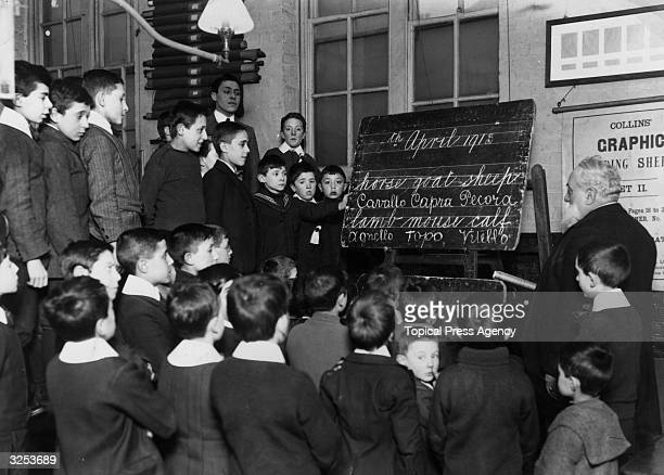 English lessons for Italian children at a school in Soho, Signor de Villa instructs boys in reading and spelling.