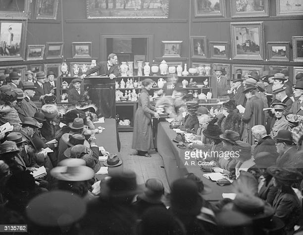Prospective bidders at an auction held at Christie's in aid of the Red Cross
