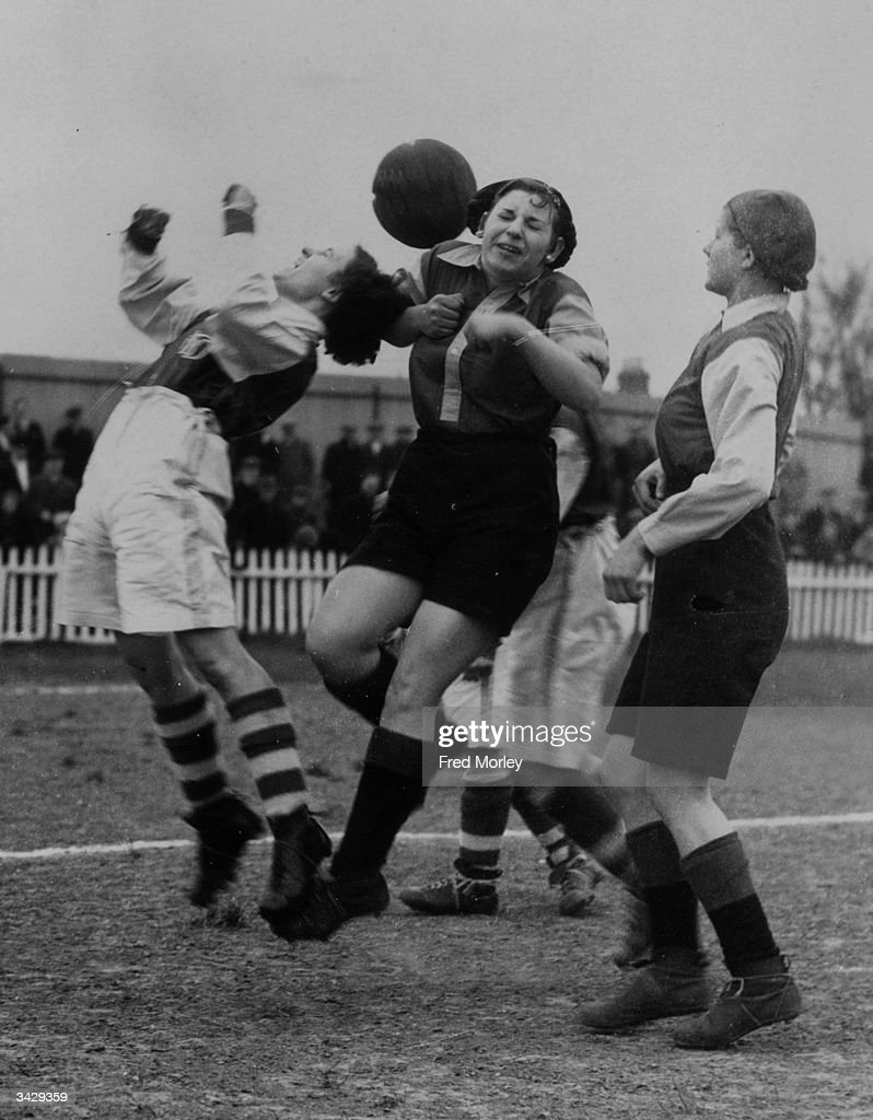 A mid-field manoeuvre during the Dagenham Docks versus Hayes women's football match on the Merry Fiddlers Ground, Becontree Heath. The winners are entitled to hold the Marine Cup for one year.