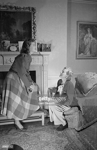 Upandcoming actress Sally Cooper is helped with the lines for her stage role in 'Edward My Son' by an old hand her mother Dame Gladys Cooper at their...