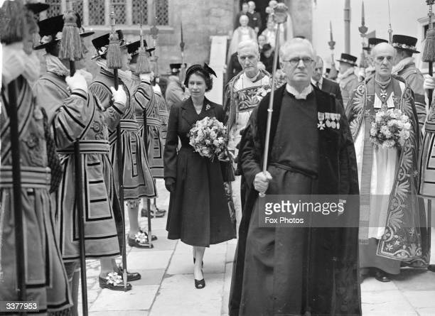 Queen Elizabeth II leaving Westminster Abbey London through a guard of honour of Yeoman of the Guard after carrying out the ancient ceremony of...