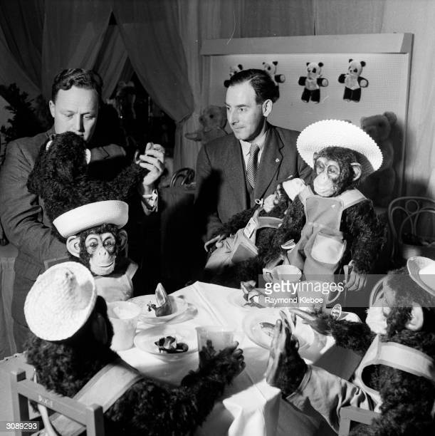 A buyer at the Toy Manufacturers' Fair in Brighton attends a tea party hosted by a group of toy chimps Original Publication Picture Post 7111 Britain...