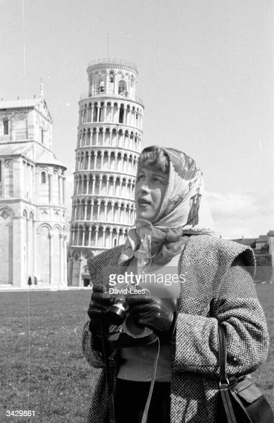 Transsexual Roberta Cowell, formerly Robert Cowell visits the Leaning Tower of Pisa. Roberta was once a Spitfire pilot, prisoner-of-war, racing...