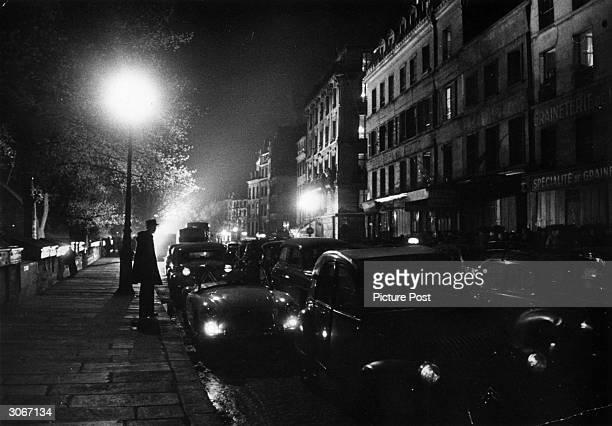 Paris Quai on the Left Bank during Queen Elizabeth II's visit to France. Original Publication: Picture Post - 8890 - The Queen Conquers France -...