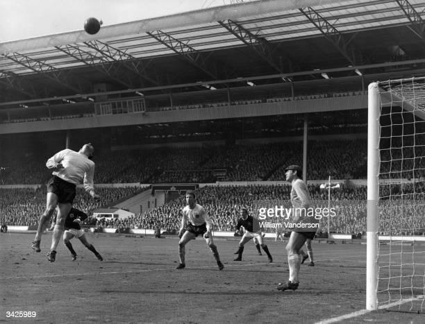 English goalkeeper Gordon Banks his teammate Jack Charlton and the Scottish striker Denis Law watching the ball during an international match at...