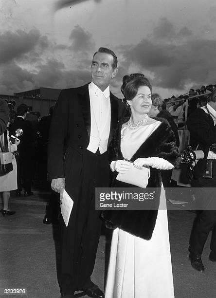 EXCLUSIVE Married American actors Fred MacMurray and June Haver smile as they arrive for the Academy Awards at the Santa Monica Civic Auditorium...