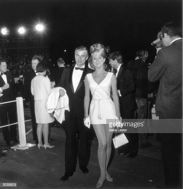 EXCLUSIVE Swedishborn actor Inger Stevens smiles with her unidentified date as they attend the 39th Annual Academy Awards Santa Monica California She...