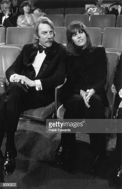 Canadian actor Donald Sutherland wearing a tuxedo sits next to American actor Jane Fonda at the Academy Awards Dorothy Chandler Pavilion Los Angeles...