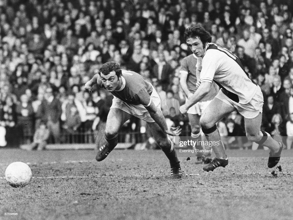 Keith Weller, the Leicester City skipper (left) competes for the ball with, Crystal Palace's Tony Taylor.