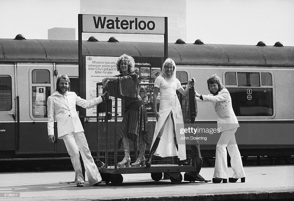 Swedish pop stars (from left), Benny Andersson, Anni-Frid Lyngstad, Agnetha Faltskog and Bjorn Ulvaeus of the Swedish pop group ABBA posing at Waterloo railway station.
