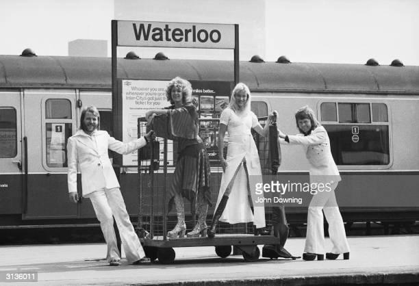 Swedish pop stars , Benny Andersson, Anni-Frid Lyngstad, Agnetha Faltskog and Bjorn Ulvaeus of the Swedish pop group ABBA posing at Waterloo railway...