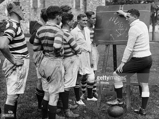 Vivian Gordon James Jenkins the Welsh Rugby international and Glamorgan County cricketer discussing rugby tactics with players at Dover College