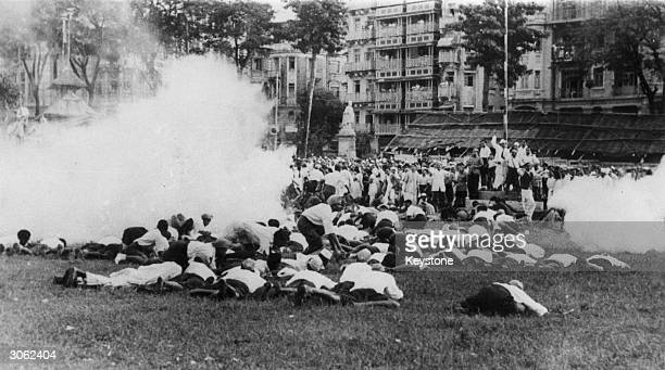 Demonstrators lying on the ground to avoid clouds of tear gas released by the police when they refused to disperse after protesting against the...