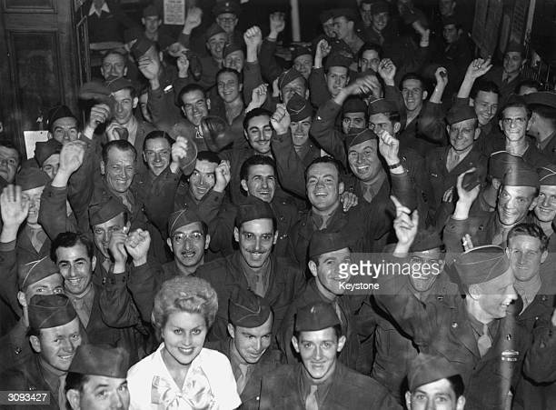 American GI's in the Rainbow Corner Club in London's Piccadilly Circus celebrate the news of the Japanese surrender on VJ Day