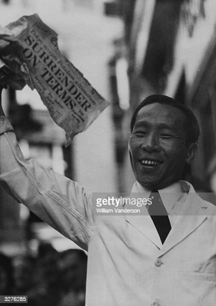 Joyful Chinese waiters join Londoners in celebrating the news of Japan's surrender.
