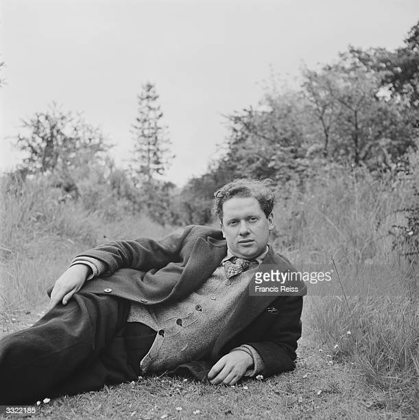 Welsh poet and playwright Dylan Thomas relaxing outside Original Publication Picture Post 4156 Nest Of Singing Birds pub 1946