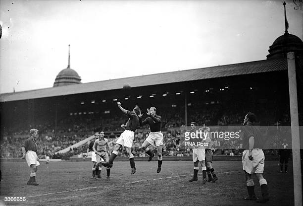 Ejgil Nielsen Denmark's goalkeeper leaps up to intercept the ball during the 1948 Olympic semifinal match at Wembley London between Denmark and Sweden
