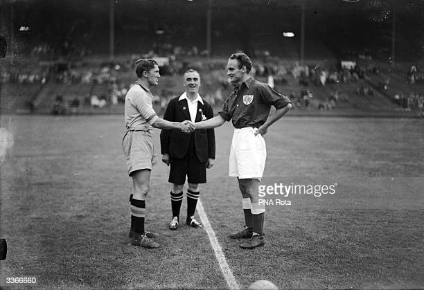 The captains of the Denmark and the Sweden football teams shake hands in the presence of the referee before the start of the 1948 Olympic semifinal...