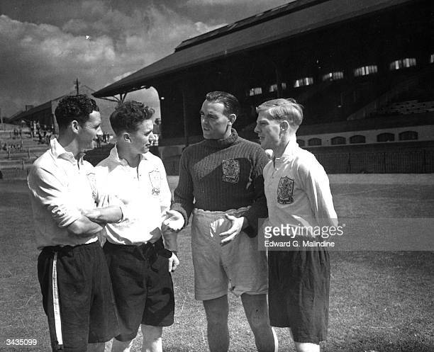 From left to right Jenkins J Campbell goalkeeper Hugh Kelly and winghalf Robin Lawler discuss points at the Craven Cottage football ground in London...