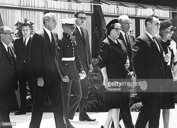 American baseball player Joe DiMaggio attends the funeral of film star Marilyn Monroe with his son Joe Junior and Monroe's halfsister Bernice Miracle