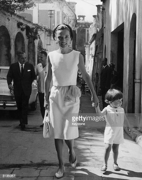 Princess Lee Radziwill, the sister of Jackie Kennedy, with her young son Anthony Radziwill in Ravello. Prince Radziwill is walking behind his wife on...